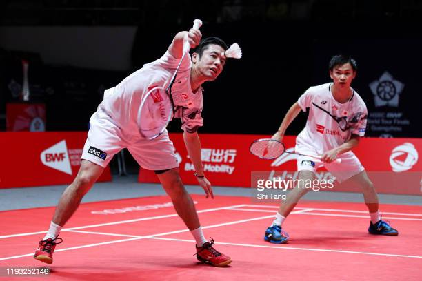 Hiroyuki Endo and Yuta Watanabe of Japan compete in the Men's Doubles round robin match against Takeshi Kamura and Keigo Sonoda of Japan during day...