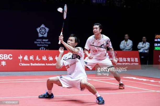 Hiroyuki Endo and Yuta Watanabe of Japan compete in the Men's Doubles round robin match against Marcus Fernaldi Gideon and Kevin Sanjaya Sukamuljo of...