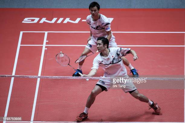 Hiroyuki Endo and Yuta Watanabe of Japan compete in the Men's Doubles round robin match against Li Junhui and Liu Yuchen of China during day three of...