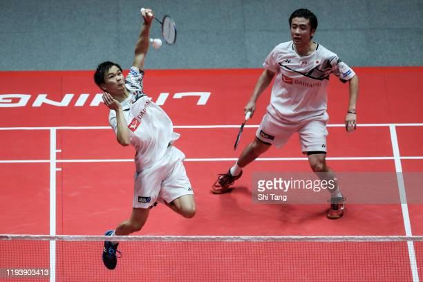 Hiroyuki Endo and Yuta Watanabe of Japan compete in the Men's Doubles semi finals match against Marcus Fernaldi Gideon and Kevin Sanjaya Sukamuljo of...