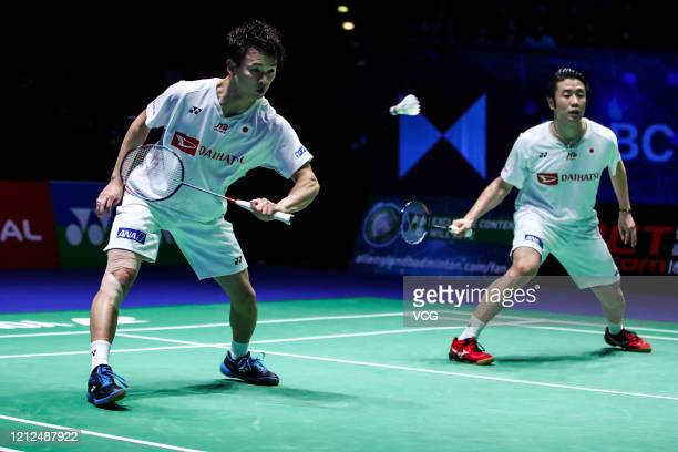 Hiroyuki Endo and Yuta Watanabe of Japan compete in the Men's Doubles semi-final match against Vladimir Ivanov and Ivan Sozonov of Russia on day four...