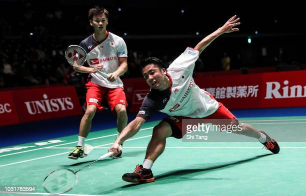 Hiroyuki Endo and Yuta Watanabe of Japan competes in the Men's Doubles first round match against Mohammad Ahsan and Hendra Setiawan of Indonesia on...