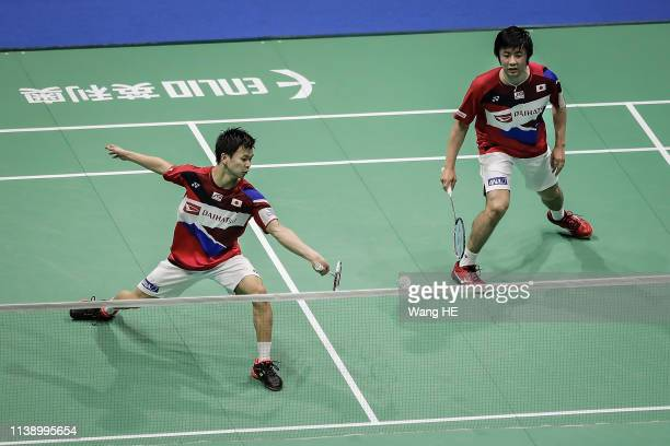Hiroyuki Endo and Yuta Watanabe of Japan in action during the men's doubles match against Tinn Isriyanet and Kittisak Namdash of Thailand at the 2019...