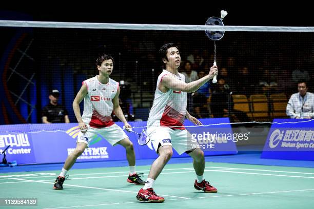 Hiroyuki Endo and Yuta Watanabe of Japan in action during the Men's Doubles Semifinal match against Min Hyuk Kang and Kim Won Ho of Korea at the 2019...