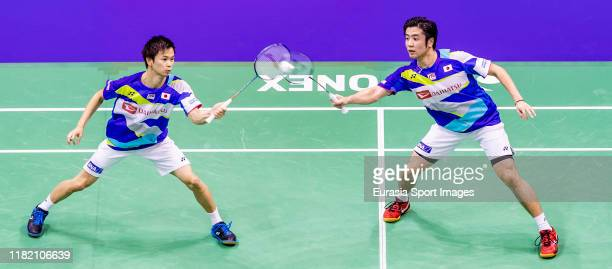 Hiroyuki Endo and Yuta Watanabe of Japan in action during the men's doubles against He Ji Ting and Tan Qiang of China on day two of the YonexSunrise...
