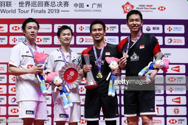 Hiroyuki Endo and Yuta Watanabe of Japan Mohammad Ahsan and Hendra Setiawan of Indonesia pose with their trophies after the Men's Double final match...