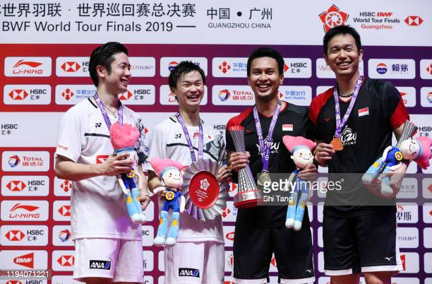 Hiroyuki Endo and Yuta Watanabe of Japan, Mohammad Ahsan and Hendra Setiawan of Indonesia pose with their trophies after the Men's Double final match...