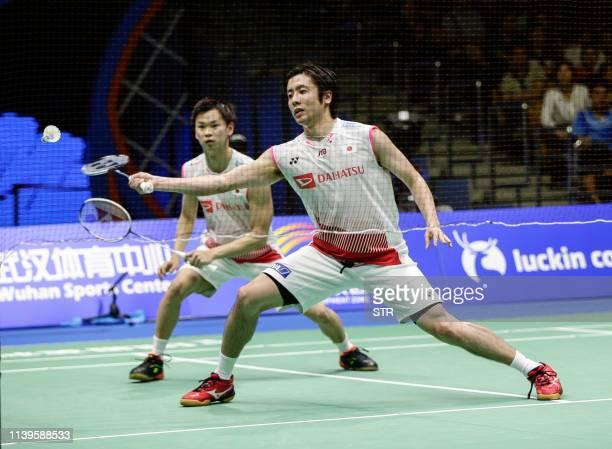 Hiroyuki Endo and Yuta Watanabe of Japan play a return against Kang Minhyuk and Kim Wonho of South Korea during their men's doubles semifinal match...