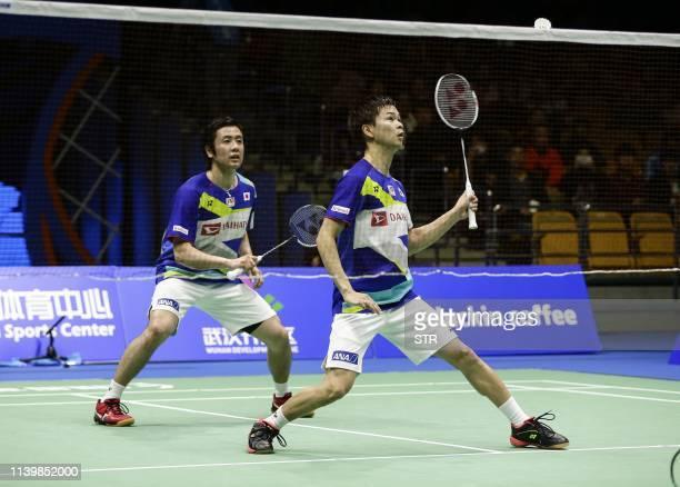 Hiroyuki Endo and Yuta Watanabe of Japan play a return against Marcus Fernaldi Gideon and Kevin Sanjaya Sukamuljo of Indonesia during their men's...