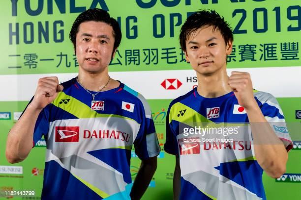 Hiroyuki Endo and Yuta Watanabe of Japan pose after winning the men's doubles against Marcus Fernaldi Gideon and Kevin Sanjaya Sukamuljo of Indonesia...
