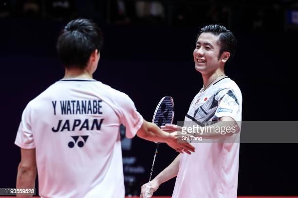 Hiroyuki Endo and Yuta Watanabe of Japan react in the Men's Doubles round robin match against Marcus Fernaldi Gideon and Kevin Sanjaya Sukamuljo of...