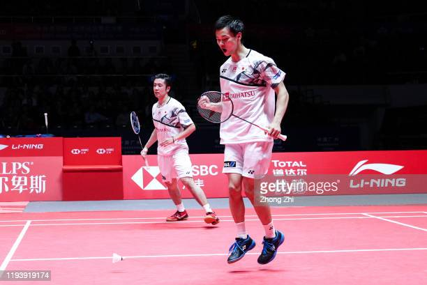 Hiroyuki Endo and Yuta Watanabe of Japan reacts during the men's doubles semi final match against Marcus Fernaldi Gideon and Kevin Sanjaya Sukamuljo...