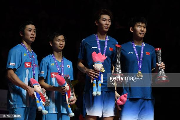 Hiroyuki Endo and Yuta Watanabe of Japan with Liu Yuchen and Li Junhui of China pose with their trophy after the men's doubles final match on day 5...