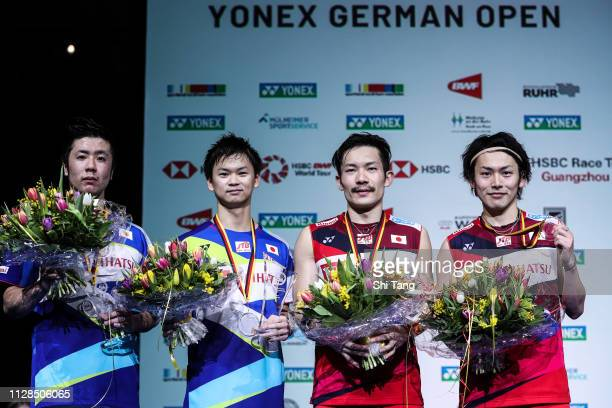 Hiroyuki Endo Yuta Watanabe Keigo Sonoda and Takeshi Kamura of Japan pose with their trophies after the Men's Double final match during day six of...
