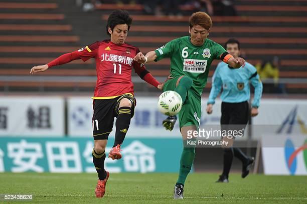 Hiroyuki Furuta of Zweigen Kanazawa and Keiji Takachi of FC Gifu compete for the ball during the JLeague second division match between Zweigen...
