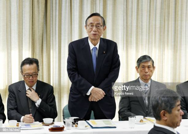 Hiroyuki Hosoda head of the Liberal Democratic Party's constitutional reform panel speaks at a meeting of the panel in Tokyo on March 14 2018 The...