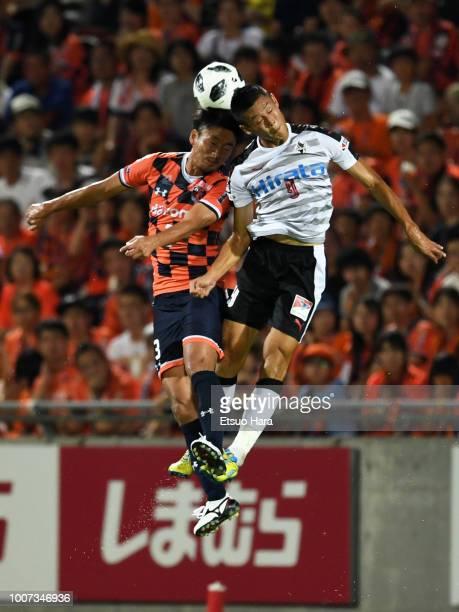 Hiroyuki Komoto of Omiya Ardija and An Byong Jun of Roasso Kumamoto compete for the ball during the J.League J2 match between Omiya Ardija and Roasso...