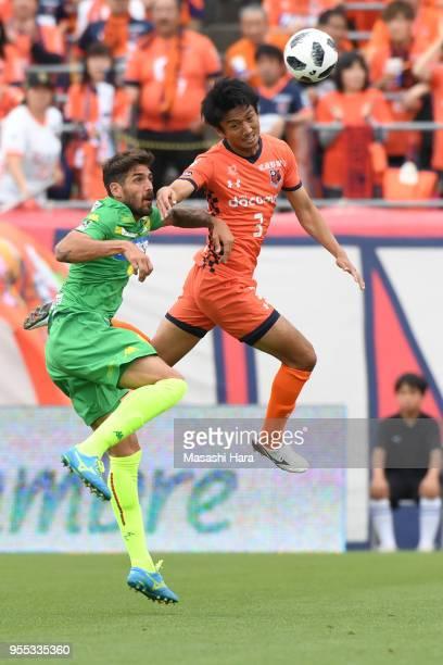 Hiroyuki Komoto of Omiya Ardija and Larrivey of JEF United Chiba compete for the ball during the JLeague J2 match between Omiya Ardija and JEF United...
