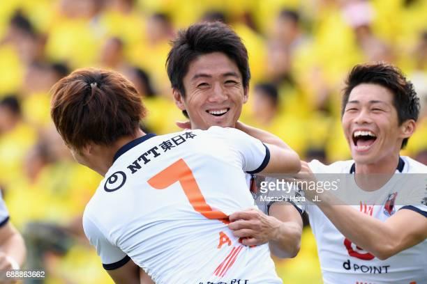Hiroyuki Komoto of Omiya Ardija celebrates scoring the opening goal with his team mates Ataru Esaka and Yusuke Segawa during the JLeague J1 match...