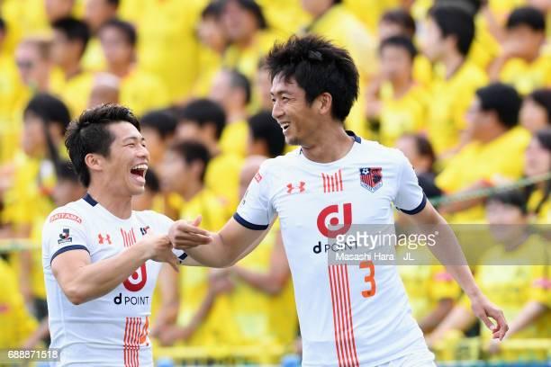 Hiroyuki Komoto of Omiya Ardija celebrates scoring the opening goal with his team mate Yusuke Segawa during the JLeague J1 match between Kashiwa...