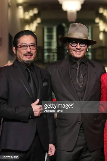 Hiroyuki Sanada and Johnny Depp arrive for the Minamata premiere during the 70th Berlinale International Film Festival Berlin at FriedrichstadtPalast...
