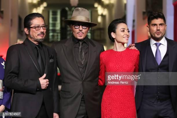Hiroyuki Sanada Johnny Depp Minami and director Andrew Levitas pose at the Minamata premiere during the 70th Berlinale International Film Festival...