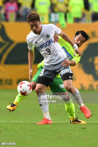 Hiroyuki Takasaki of Matsumoto Yamaga and Yuto Sato of JEF United Chiba compete for the ball during the JLeague J2 match between JEF United Chiba and...