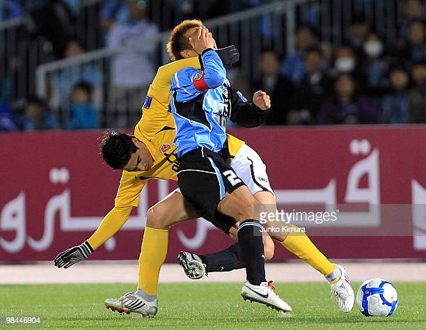 Hiroyuki Taniguchi of Kawasaki Frontale and Molina of Seongnam Ilhwa compete for the ball during the AFC Champions League match between Kawasaki...