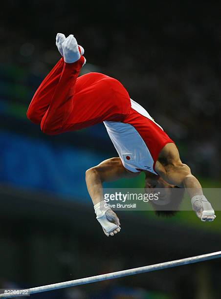 Hiroyuki Tomita of Japan competes in the Horizontal Bar in the men's team final of the artistic gymnastics event held at the National Indoor Stadium...