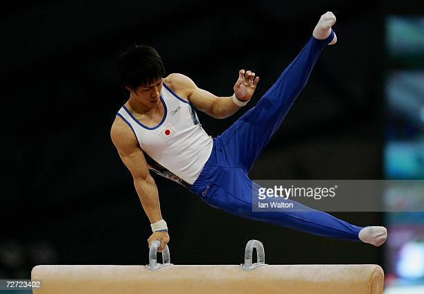 Hiroyuki Tomita of Japan competes in the Pommel Horse final during the Artistic Gymnastics competition during the 15th Asian Games Doha 2006 at The...