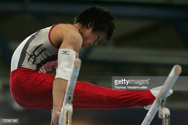 Hiroyuki Tomita of Japan performs at the parallel bars competition during the 2006 International Gymnastics DTB Cup at the Schleyer Hall on October...