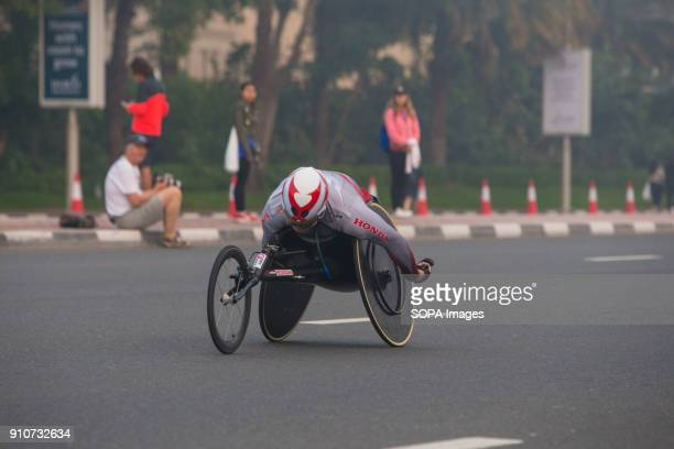 Hiroyuki Yamamoto of Japan is in action during the Standard Chartered Dubai Marathon for Wheel Chairs He came second in a time of 12718