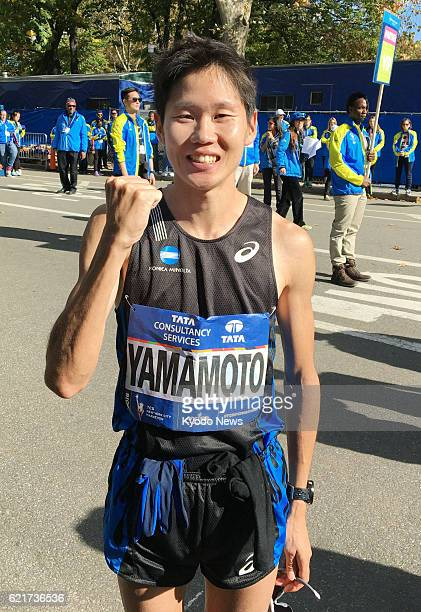 Hiroyuki Yamamoto poses for a photo after finishing fourth in the men's race of the New York City Marathon on Nov 6 the best result ever for a...
