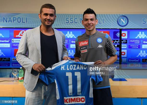 Hirving Lozano and Eduardo De Laurentiis pose as SSC Napoli sign Hirving Lozano on August 27 2019 in Naples Italy