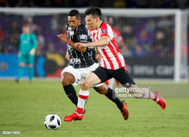 Hirving Lozano of Dutch club PSV Eindhoven is challenged by Leo Pricipe of Brazilian club Corinthians during their Florida Cup soccer game at Orlando...