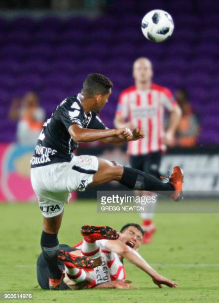Hirving Lozano of Dutch club PSV Eindhoven suffers a hard tackle by Leo Pricipe of Brazilian club Corinthians during their Florida Cup soccer game at...