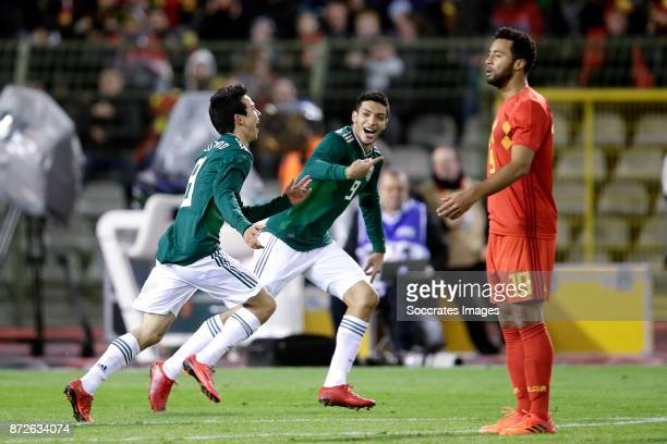 Hirving Lozano of Mexico celebrates 23 with Raul Jimenez of Mexico during the International Friendly match between Belgium v Mexico at the Koning...