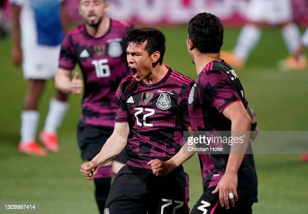 Hirving Lozano of Mexico celebrates after scoring their side's first goal during the International Friendly match between Costa Rica and Mexico at...