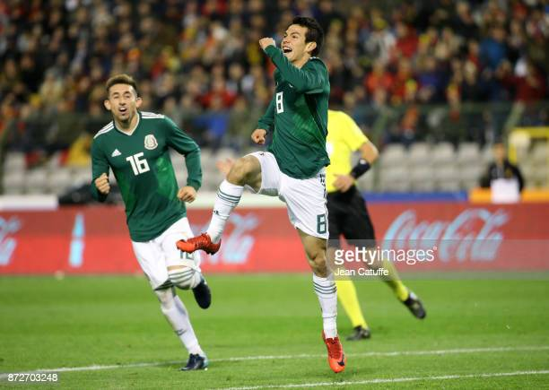 Hirving Lozano of Mexico celebrates his first goal with Hector Herrera during the international friendly match between Belgium and Mexico at King...