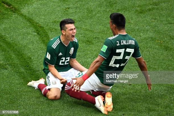 Hirving Lozano of Mexico celebrates with Jesus Gallardo by sliding on their knees after scoring his team's first goal during the 2018 FIFA World Cup...