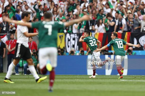 Hirving Lozano of Mexico celebrates with team mate Andres Guardado of Mexico after scoring his team's first goal during the 2018 FIFA World Cup...