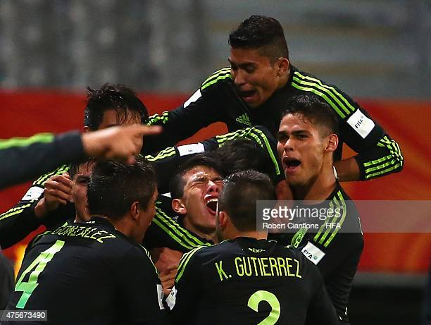 Hirving Lozano of Mexico celebrates with team mates after scoring a goal during the FIFA U20 World Cup New Zealand 2015 Group D match between Mexico...