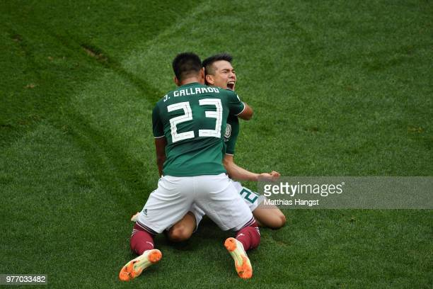 Hirving Lozano of Mexico celebrates with teammate Jesus Gallardo by sliding on his knees after scoring his team's first goal during the 2018 FIFA...