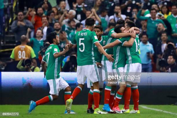 Hirving Lozano of Mexico celebrates with teammates after scoring the second goal of his team during the match between Mexico and Honduras as part of...