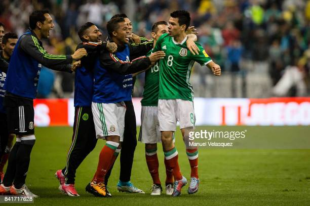 Hirving Lozano of Mexico celebrates with teammates after scoring the first goal of his team during the match between Mexico and Panama as part of the...