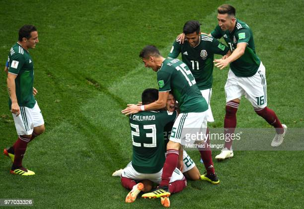 Hirving Lozano of Mexico celebrates with teammates by sliding on his knees after scoring his team's first goal during the 2018 FIFA World Cup Russia...