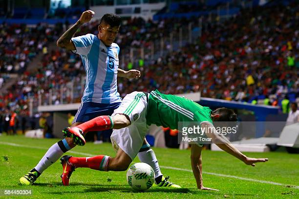 Hirving Lozano of Mexico fights for the ball with Lucas Romero of Argentina during an U23 International Friendly between Mexico and Argentina at...