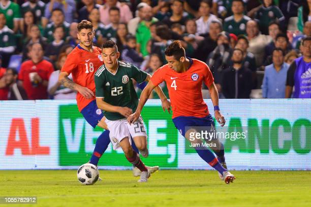 Hirving Lozano of Mexico fights for the ball with Mauricio Isla of Chile during the international friendly match between Mexico and Chile at La...