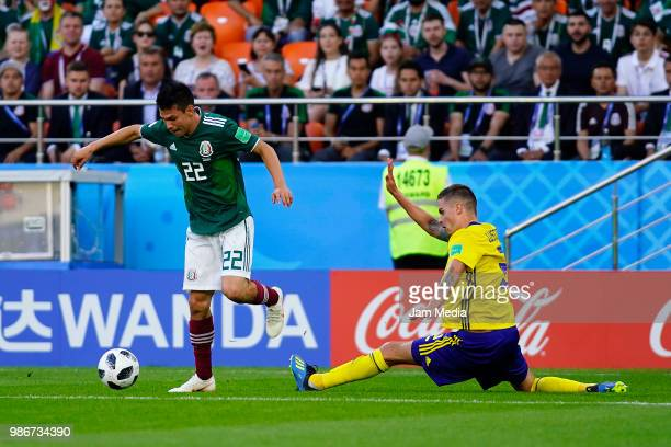Hirving Lozano of Mexico fights for the ball with Mikael Lustig of Sweden during the 2018 FIFA World Cup Russia group F match between Mexico and...