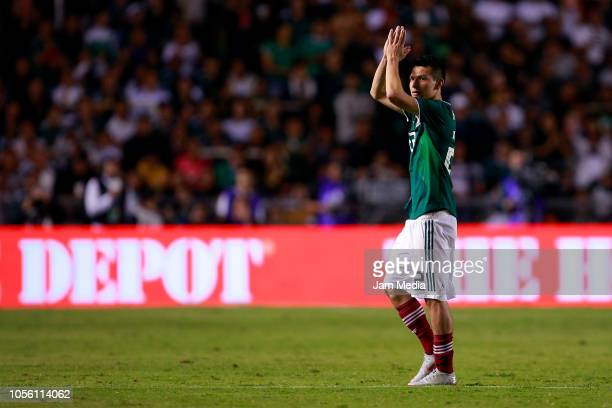 Hirving Lozano of Mexico greets fans during the international friendly match between Mexico and Chile at La Corregidora Stadium on October 16 2018 in...